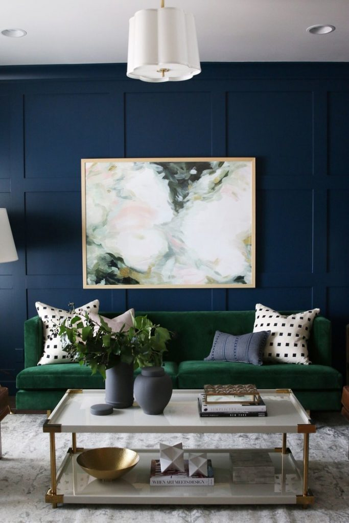 Green velvet sofa inspiration and product round-up. BOHO STYLE: THE GREEN VELVET SOFA - 6 STYLISH OPTIONS - heydjangles.com. Image via Studio McGee. Boho living room, velvet sofa inspiration, moody living room, luxe living room.