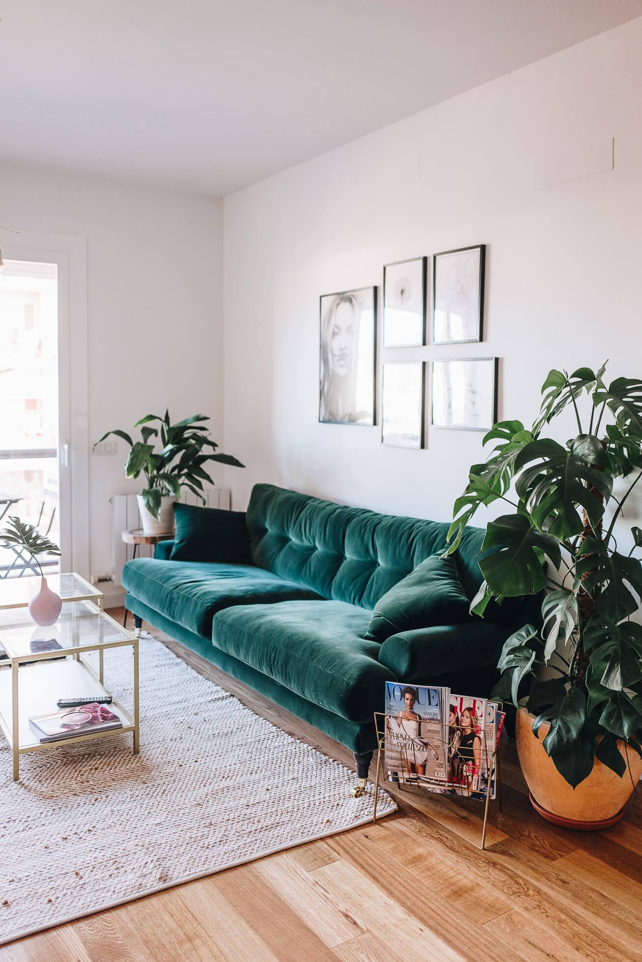 Green velvet sofa inspiration and product round-up. BOHO STYLE: THE GREEN VELVET SOFA - 6 STYLISH OPTIONS - heydjangles.com. Image via Janni Deler. Boho living room, boho sofa, velvet sofa inspiration #bohochic #bohostyle