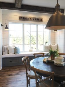 FARMHOUSE DECOR: THE RUSTIC ROUND DINING TABLE - 8 OPTIONS UNDER $650 - heydjangles.com - Image credit: The Inspired Room. Round wooden dining table, round dining room table, round wood dining table, round farmhouse dining table, farmhouse kitchen, farmhouse dining room, distressed round dining table, round breakfast nook table. #farmhousestyle #modernfarmhouse
