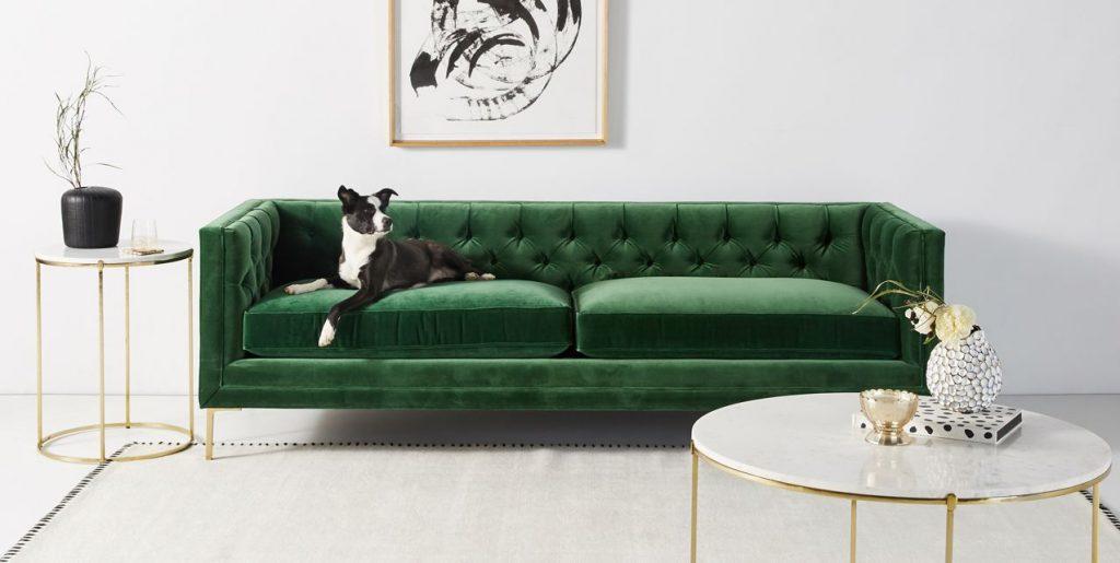 Image via Anthropologie feat. 'Mina Two-Cushion Sofa' in Emerald Velvet