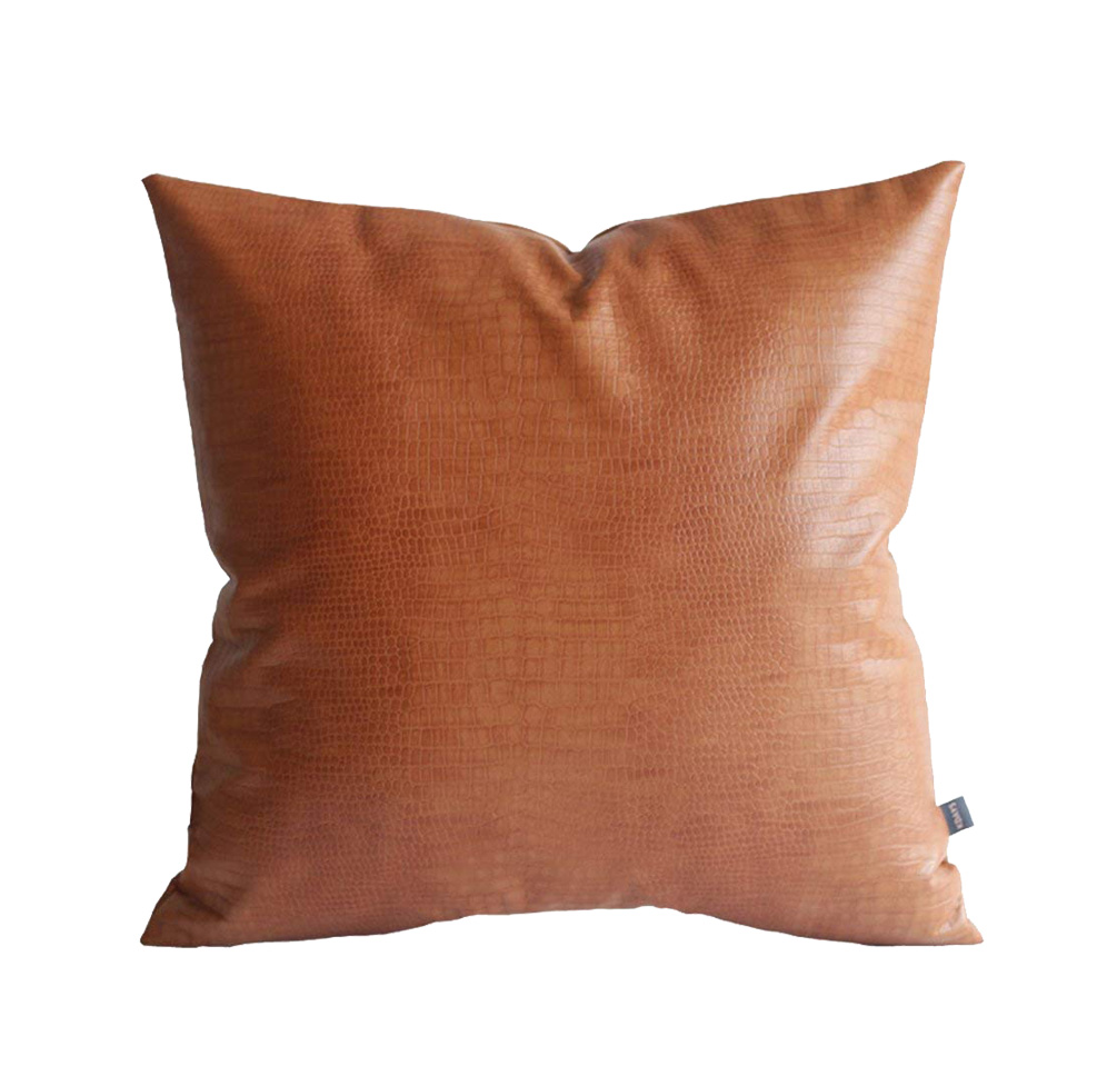 tan pillow cover, moody blue bedroom