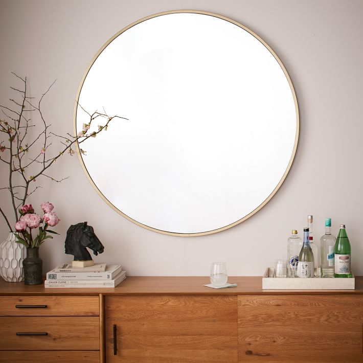 20+ WAYS TO STYLE AN OVERSIZED GOLD ROUND WALL MIRROR heydjangles.com- in entryways, bathrooms, bedrooms, living rooms and more, the oversized round wall mirror is just so chic and versatile! Large round wall mirror inspiration, round gold mirror ideas, round wall mirror decorating ideas. Image source: West Elm