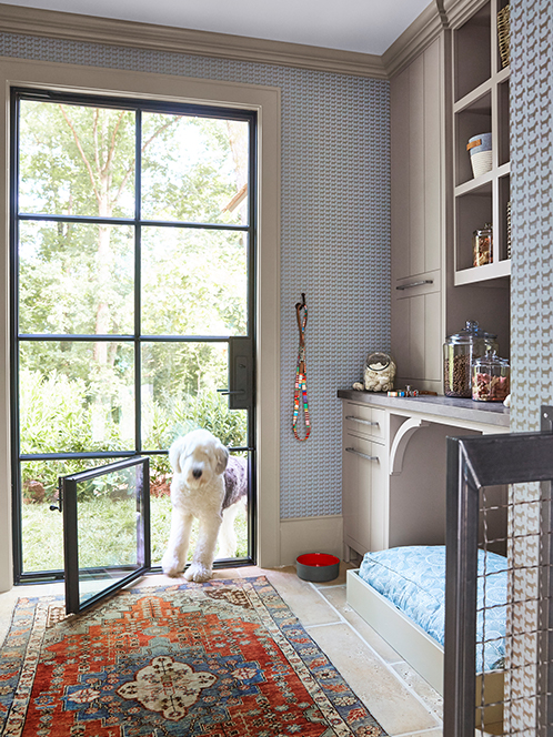 NON-NEGOTIABLE DOG ROOM DECOR ESSENTIALS – heydjangles.com – From dog bowls, pet beds, toys and tech, to pet gates, crates, dog doors and more. Check out our dog room decor wrap-up for all the best dog room decorating ideas and inspiration. Old English Sheepdog, built-in dog bed, dog door and pet gate. Photo credit: Circa Lighting, Photography: Victoria Pearson.