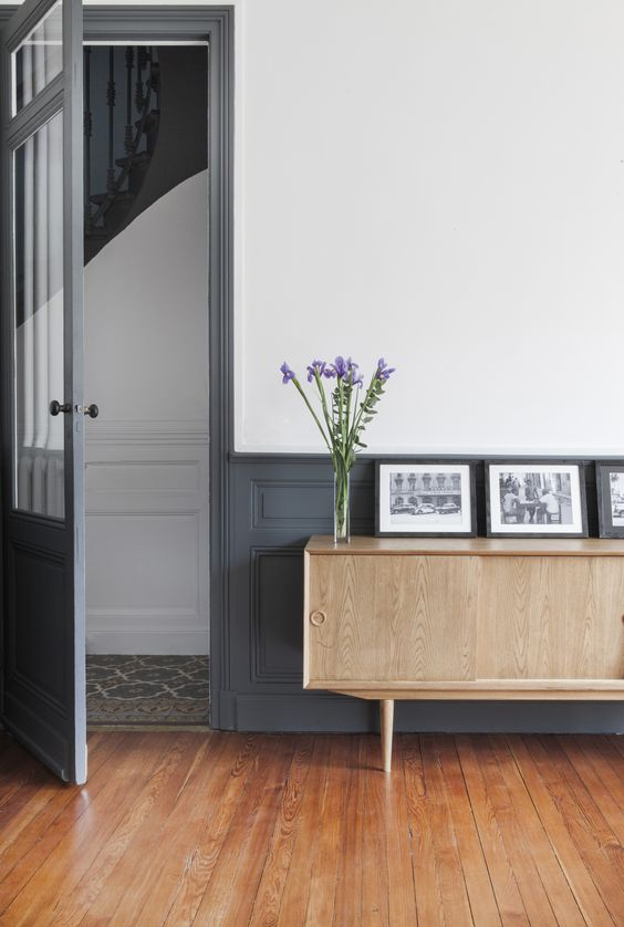 TREND: COLOR BLOCKED WALLS & DIPPED DECOR - heydjangles.com, gray and white color-blocked, half-painted wall, mid-century sideboard. For more color blocked wall ideas, check out our latest post. Image: Fusion D.