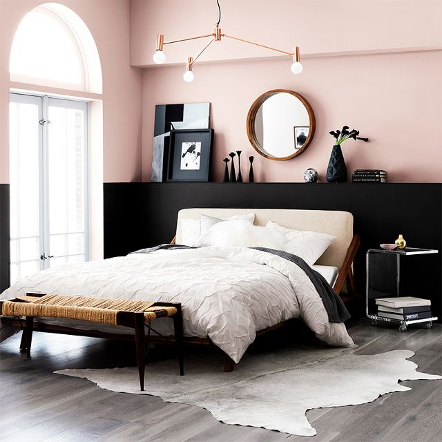 TREND: COLOR BLOCKED WALLS & DIPPED DECOR - heydjangles.com, Scandinavian inspired bedroom with pink & black color-blocked, half-painted walls. For more color blocked wall ideas, check out our latest post. Image: CB2 via MyDomaine.