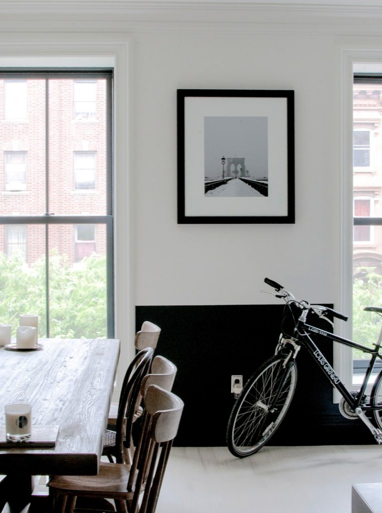 TREND: COLOR BLOCKED WALLS & DIPPED DECOR - heydjangles.com, Scandinavian inspired dining room with black & white color-blocked, half-painted walls. For more color blocked wall ideas, check out our latest post. Image: Design Sponge.