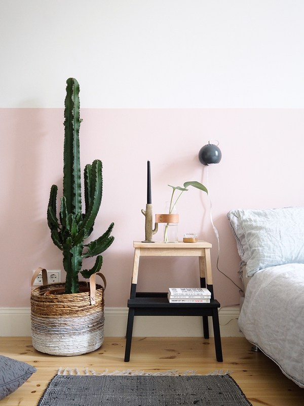 TREND: COLOR BLOCKED WALLS & DIPPED DECOR - heydjangles.com, Scandinavian inspired bedroom with pink & white color-blocked, half-painted walls and dip-dyed step stool, cactus. For more color blocked wall and dipped home decor ideas, check out our latest post. Image: La La Lovely.