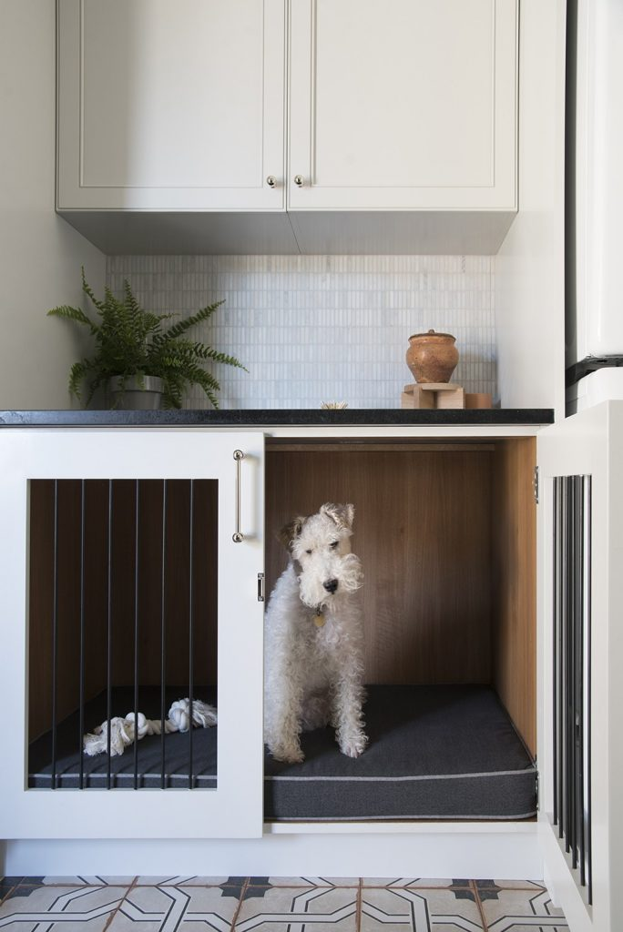 NON-NEGOTIABLE DOG ROOM DECOR ESSENTIALS – heydjangles.com – From dog bowls, pet beds, toys and tech, to pet gates, crates, dog doors and more. Check out our dog room decor wrap-up for all the best dog room decorating ideas and inspiration. Wire Fox Terrier, built-in dog crate, dog mudroom. Photo credit: Room for Tuesday.