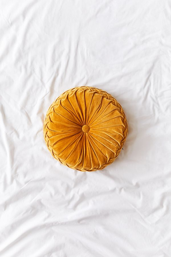 Decorating With Mustard Yellow - heydjangles.com - Super cute velvet mustard round pintuck cushion from UO. Boho style, retro decor ideas, mustard aesthetic. #retrodecor #urbanoutfitters