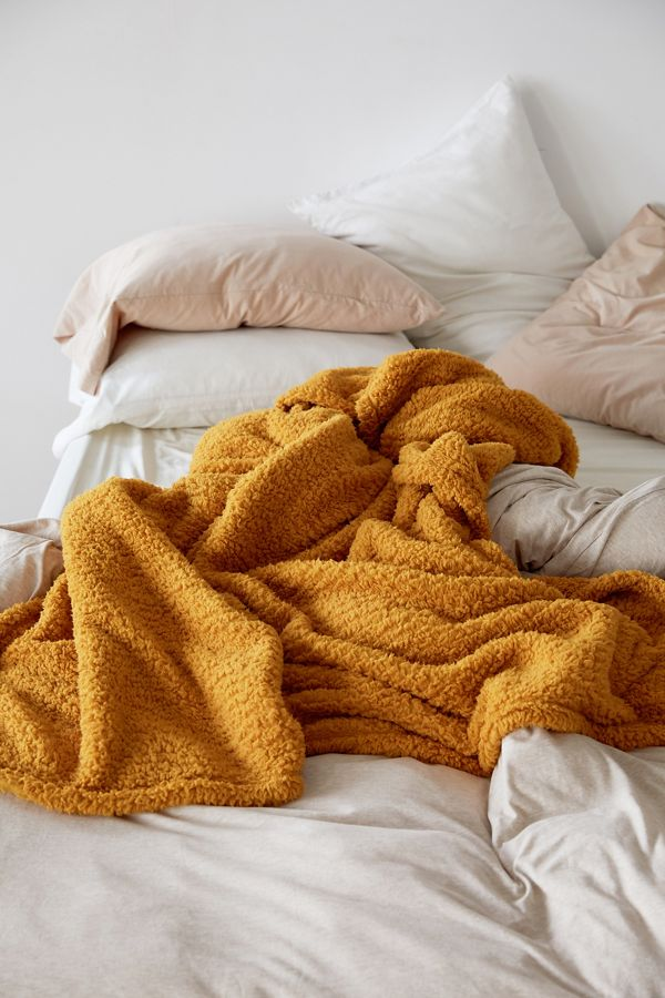 Decorating With Mustard Yellow - heydjangles.com - Love this mustard yellow fleece throw blanket from UO - looks so cozy!  #mustardaesthetic #urbanoutfitters