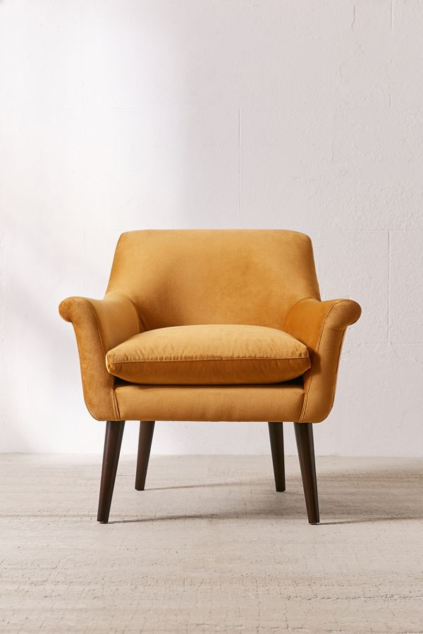 Decorating With Mustard Yellow - heydjangles.com - Gorgeous velvet mustard yellow accent chair from UO, mid-century chair, ochre, golden, burnt orange. #urbanoutfitters #mustardaesthetic