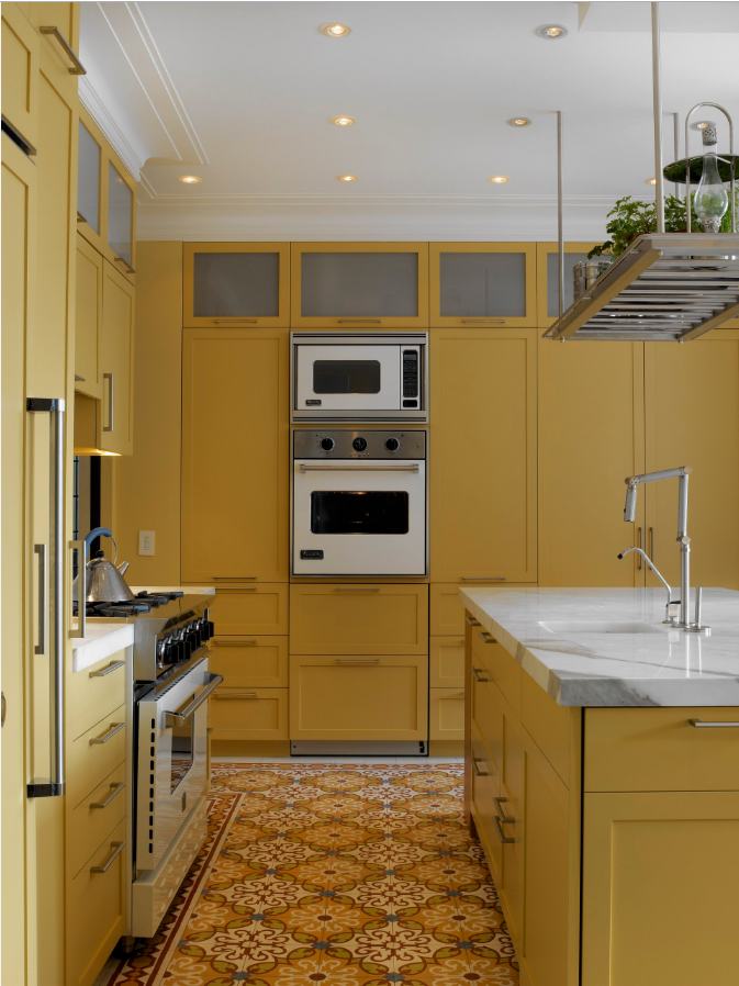 Decorating With Mustard Yellow - heydjangles.com - Monochrome all mustard yellow kitchen, mustard kitchen cabinets and marble bench top with stainless steel and white accents, very retro! Image by Laura Moss for Rusk Renovations. #kitcheninspiration #mustardaesthetic #retrodecor