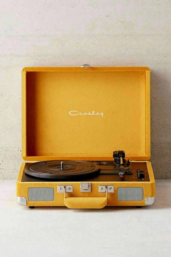 Decorating With Mustard Yellow - heydjangles.com - Love this mustard velvet retro turntable record player from UO, vintage reproduction with bluetooth. Super cute mustard yellow accent piece! #mustardyellow #crosley #mustardaesthetic #retro #urbanoutfitters