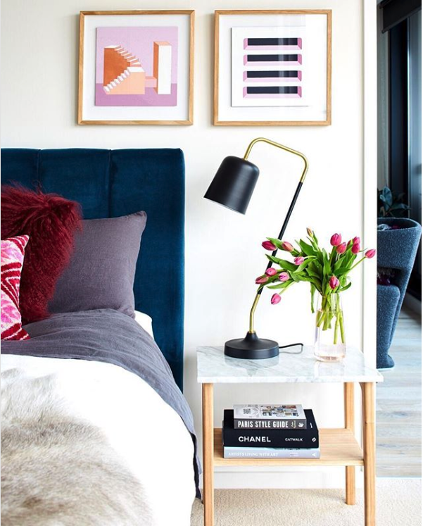 8 KEY ELEMENTS TO A MODERN & EFFORTLESSLY ECLECTIC BEDROOM - heydjangles.com - Element 6 - Proportionate side tables. Modern bedroom, eclectic styling, tulips, black and brass swing-arm lamp, blue velvet headboard, jewel tones. Image via: Fenton & Fenton