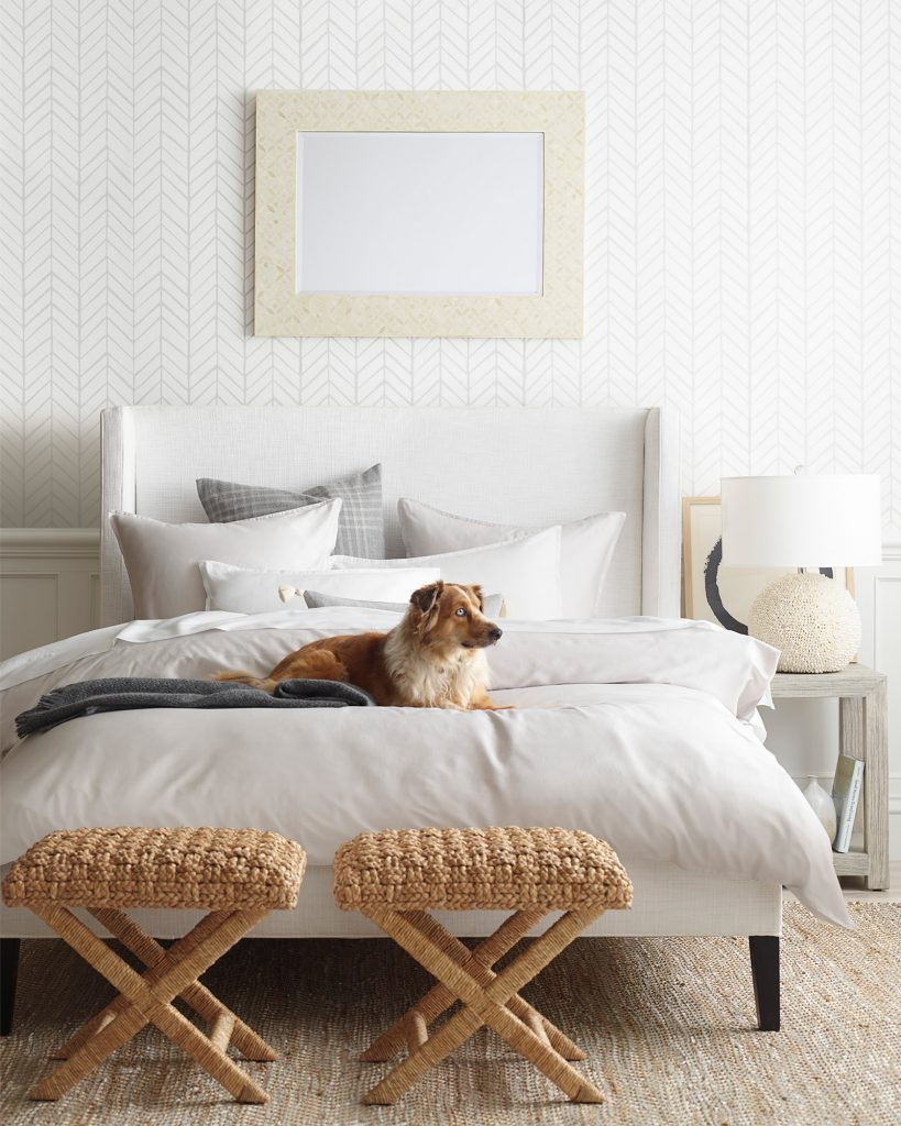 HEMP RUG BENEFITS - 7 REASONS TO CONSIDER OWNING A HEMP RUG TODAY - heydjangles.com. Australian Shepherd dog on bed, Hamptons bedroom, hand-braided x-base stool, hemp rug. Image via Serena & Lily.