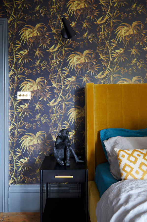 Decorating With Mustard Yellow - heydjangles.com - Gold, mustard and gray bedroom, eclectic wallpaper and decor, cute monkey lamp, mustard yellow and blue decor inspiration. Velvet mustard headboard. Image by Carmel King for Studio Milne. #eclecticbedroom #colorinspiration #mustardaesthetic