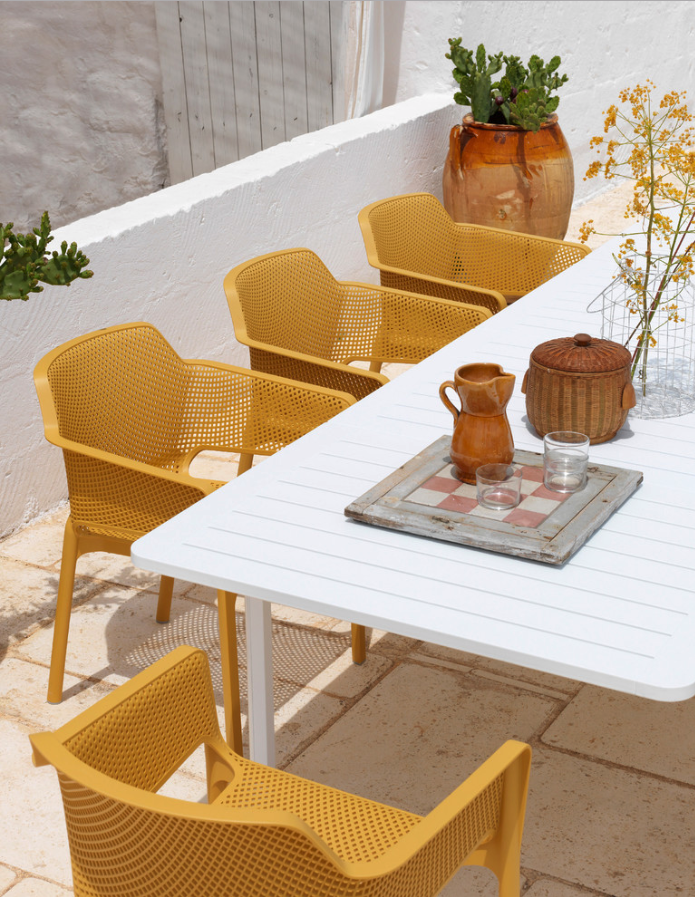Decorating With Mustard Yellow - heydjangles.com - Mediterranean style patio, mustard yellow patio chairs, terra cotta planters. Cacti. Image by ByDezign Furniture. #patioinspiration #mustardaesthetic