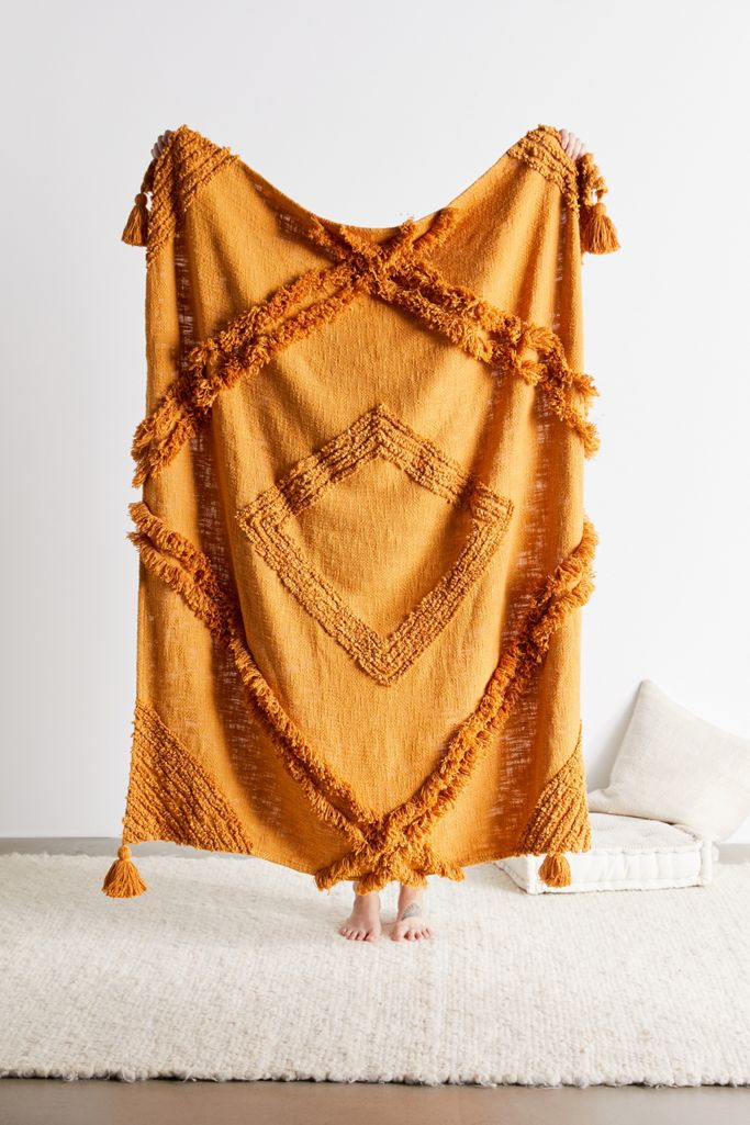 Image via Urban Outfitters feat. Aden Tufted Throw Blanket in Mustard