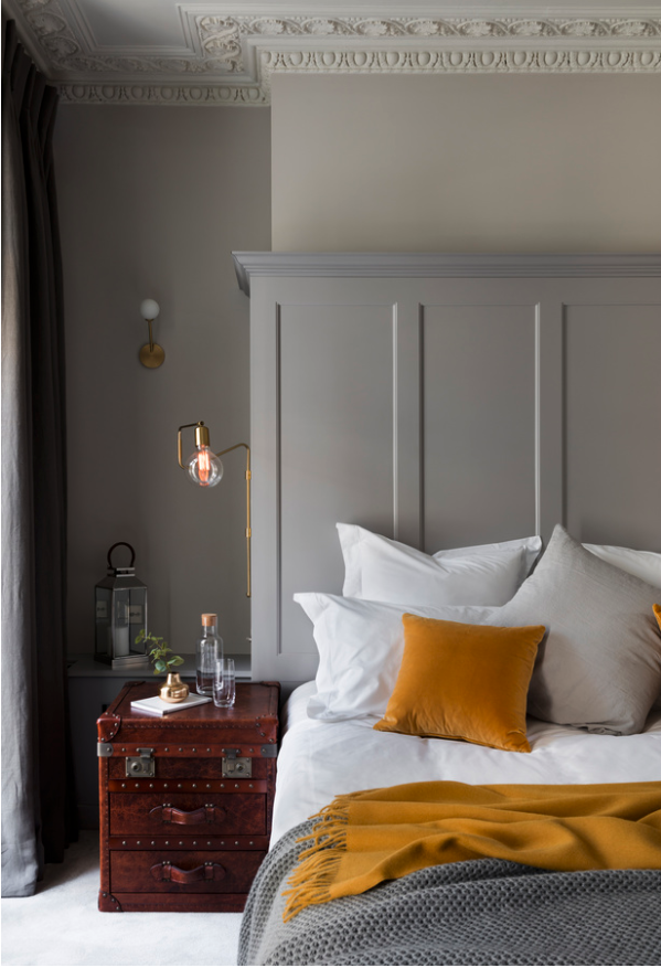 Decorating With Mustard Yellow - heydjangles.com - Gray and mustard bedroom with brass and rich wooden accents. Image by Nathalie Priem. #bedroomdecoratingideas #colorinspiration