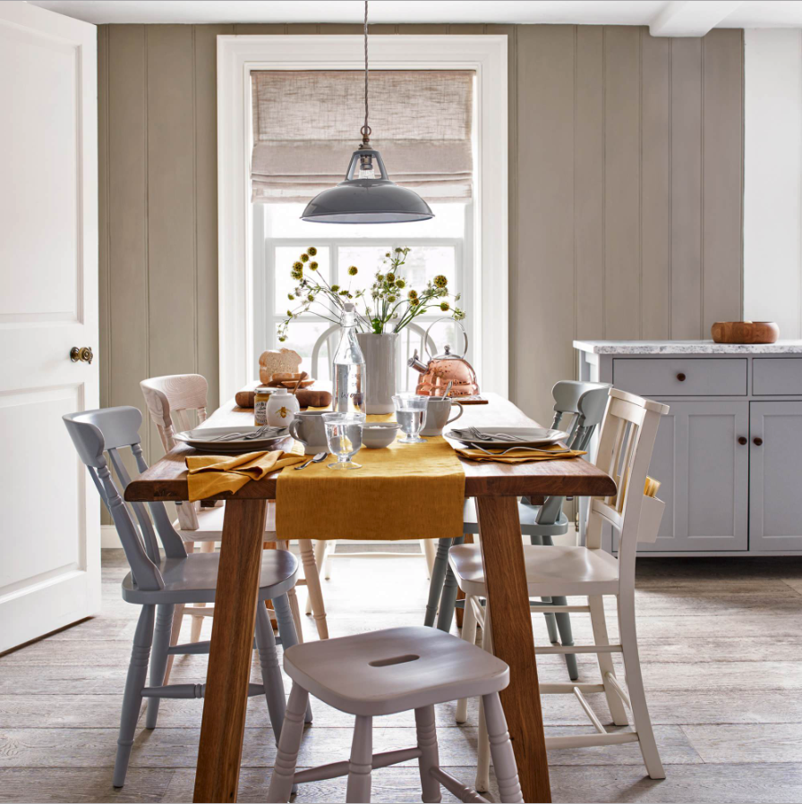 Decorating With Mustard Yellow - heydjangles.com - Mustard yellow and gray modern farmhouse kitchen, gray cabinets and industrial pendant, mismatched dining chairs add rustic charm - love it! Image by John Lewis and Partners. #farmhousekitchen #johnlewis