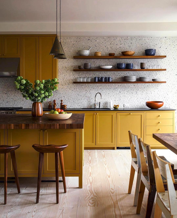 Decorating With Mustard Yellow - heydjangles.com - Mustard yellow kitchen cabinets with wooden bench top and open shelving. Image via @lonnymag. #kitchendecor #colorinspiration #mustardaesthetic