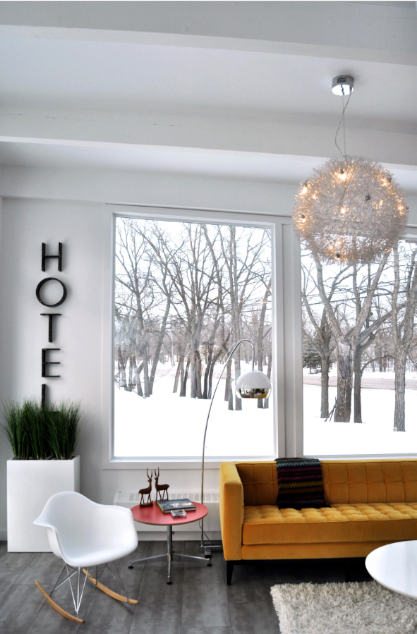 Decorating With Mustard Yellow - heydjangles.com - White Scandinavian style living room with bold mustard yellow velvet sofa, white eames rocking chair and snowy window. Image via Houzz #scandistyle #winter #snow