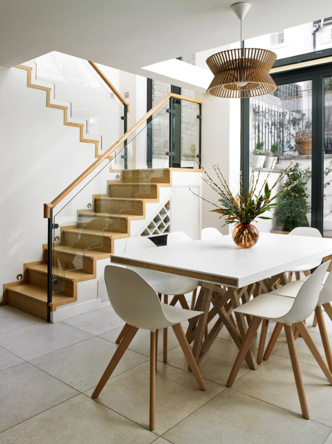 ROUND-UP: Affordable Modern Wooden Pendant Lights - heydjangles.com - Modern dining room in white with wooden accents, white Eames style chairs and beautiful statement wooden pendant light. Image by Nick Smith Photography.