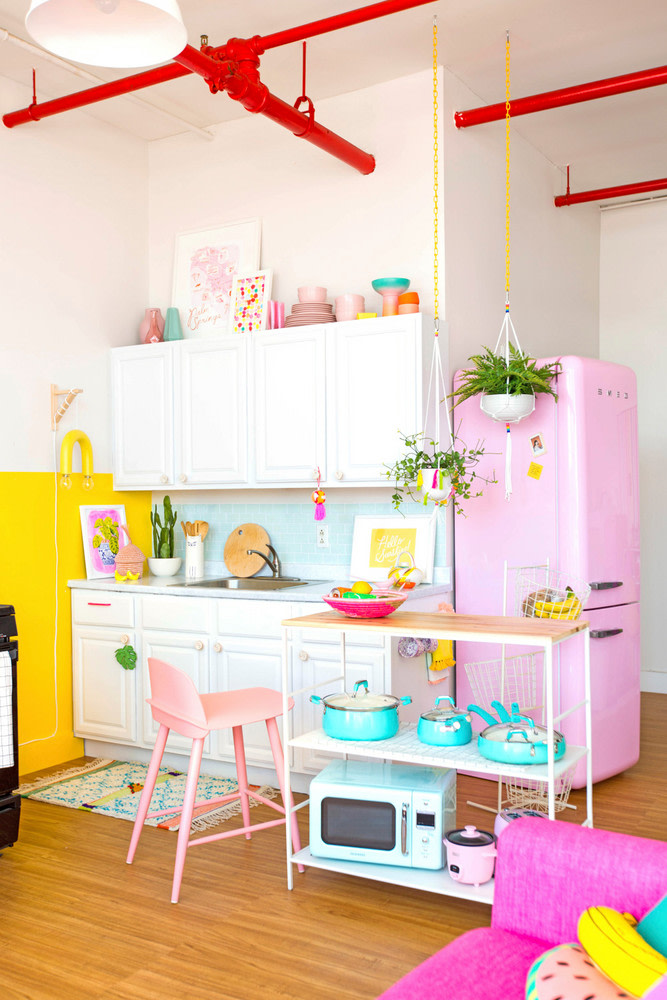 4 EASY WAYS TO ADD MODERN RETRO CHARM TO YOUR HOME - heydjangles.com - 1. With color! Bold bright cheery retro kitchen by Sam Ushiro. Retro kitchen appliances, SMEG, pastels, 50s inspired #retrovibes #50sstyle #retrodecor