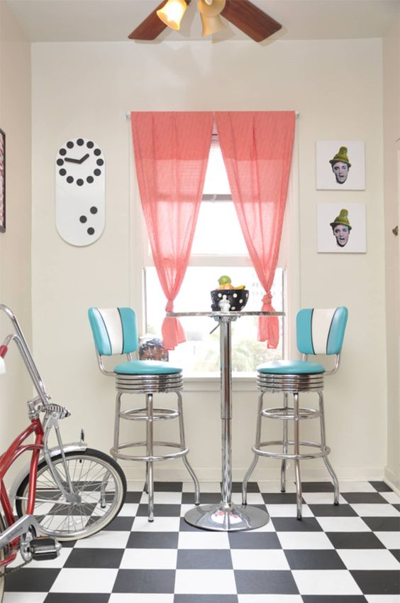 4 EASY WAYS TO ADD MODERN RETRO CHARM TO YOUR HOME - heydjangles.com - 3. With accent furniture! Retro kitchen, retro bar stools, checkerboard tiles, checkerboard floor, aluminium, retro diner, 50s inspired #retrodecor Image via Apartment Therapy.