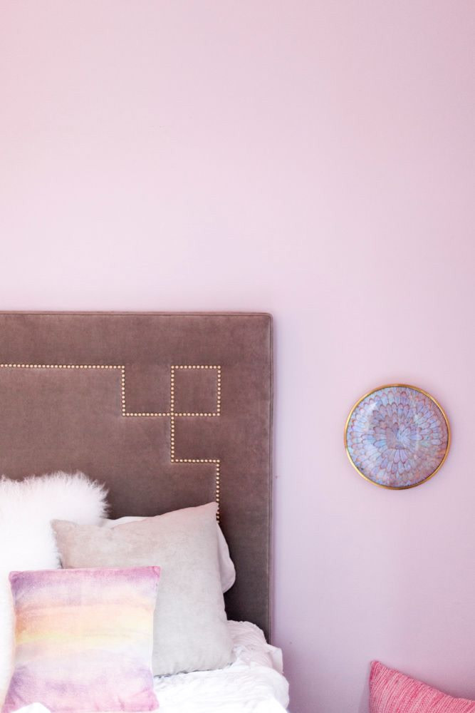 7 Gorgeous Pink Bedrooms That You Can Totally Re-create at Home - heydjangles.com. Feminine pink and lavender bedroom. Pink bedroom decor ideas. Image via Domino - Kelly Christine Sutton. #pinkbedroom #decoratingideas