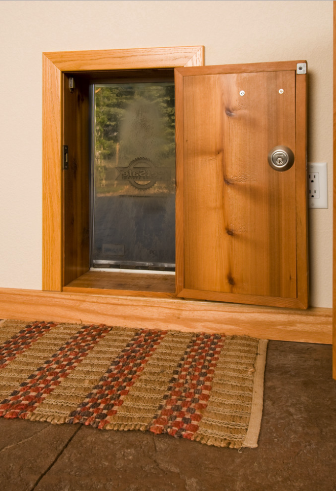 25+ STYLISH DOG DOOR IDEAS FOR THE DISCERNING PET OWNER - Hey, Djangles. Wall dog door with interior door and matching trim, wall mount dog door, pet door ideas, wooden pet door, PetSafe pet door. Image: Harper Point Photography.