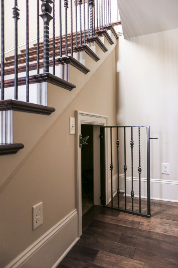 25+ STYLISH DOG DOOR IDEAS FOR THE DISCERNING PET OWNER - Hey, Djangles. Dog door under stairs, dog room under stairs, built in dog crate. Image: Livengood Photographs.