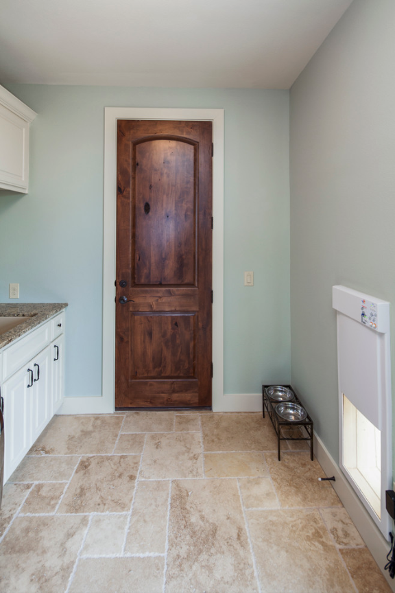 25+ STYLISH DOG DOOR IDEAS FOR THE DISCERNING PET OWNER - Hey, Djangles. Laundry dog room with ultrasonic pet door, electronic pet door, wall dog door, wall mount dog door, pet door ideas. Image: Tre Dunham.