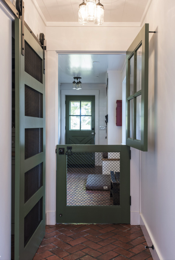 25+ STYLISH DOG DOOR IDEAS FOR THE DISCERNING PET OWNER - Hey, Djangles. Dog room ideas, mudroom dog room, dog door gate, dutch door dog gate, pet gate ideas, built in dog gate, farmhouse mudroom/laundry. Image: Andrew Hyslop.