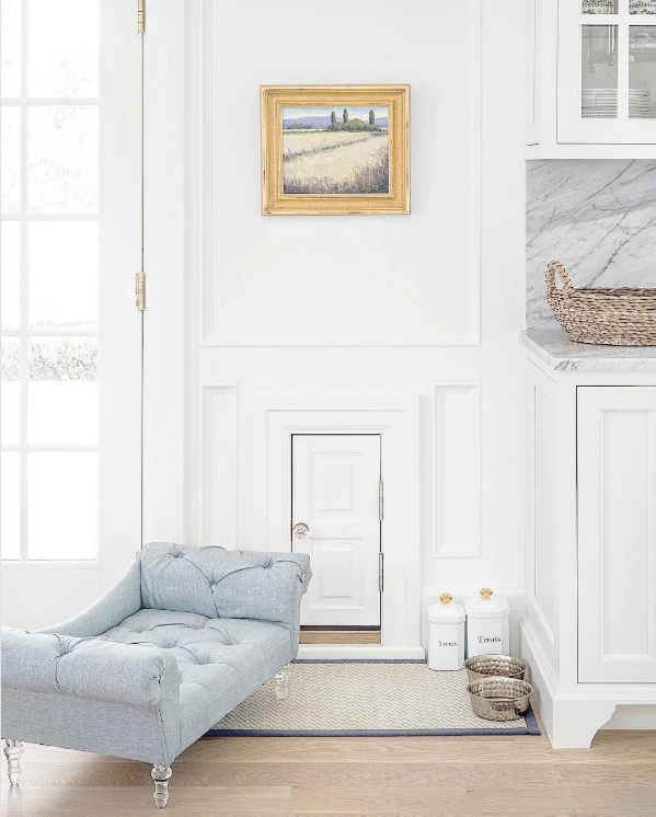 25+ STYLISH DOG DOOR IDEAS FOR THE DISCERNING PET OWNER - Hey, Djangles. Wall dog door with interior door and matching trim, wall mount dog door, pet door ideas, beautiful white kitchen with marble bench top and backsplash, tufted dog bed. Image: @the_fox_group_