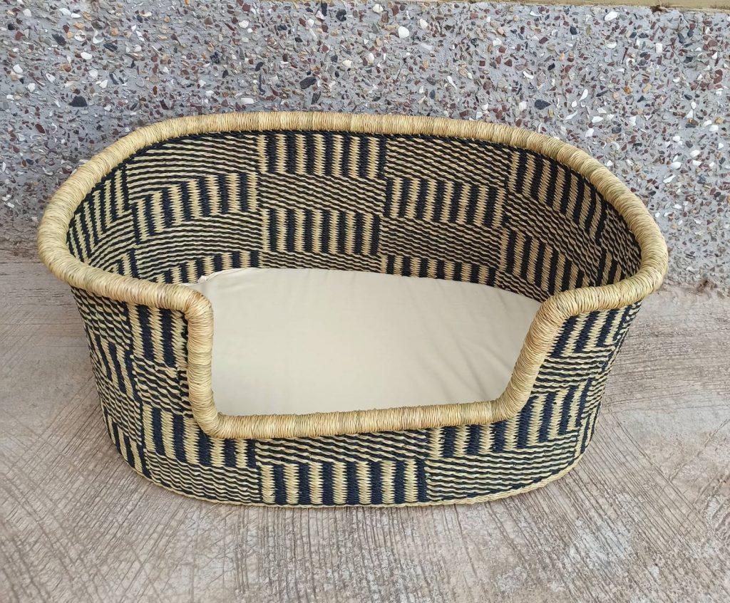 African basket woven dog basket.