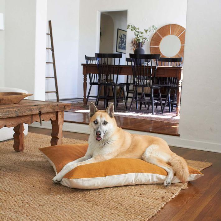 The Wolf Nest Linen Dog Bed in Ochre - via West Elm