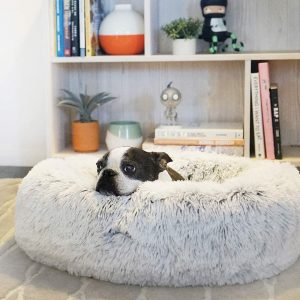 Calming Cuddler Donut Dog Bed via Amazon.